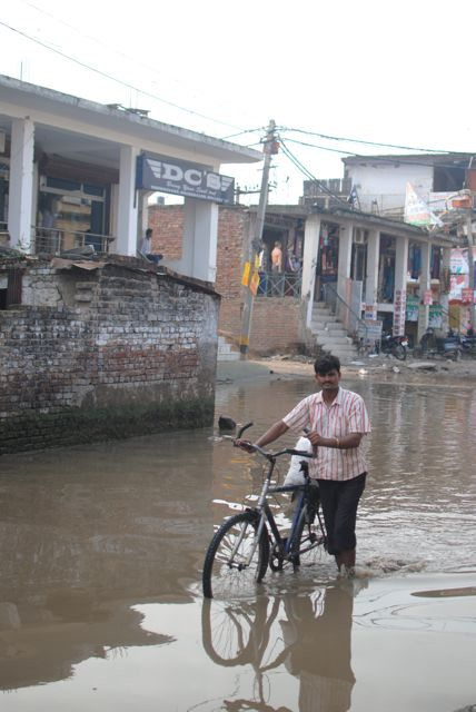 The flooded main street of Aya Nagar, where Jan Madhyam is
