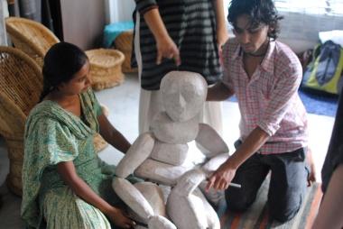 Asha, Anurupa and Anand show us their full-size Bunryaku puppet.
