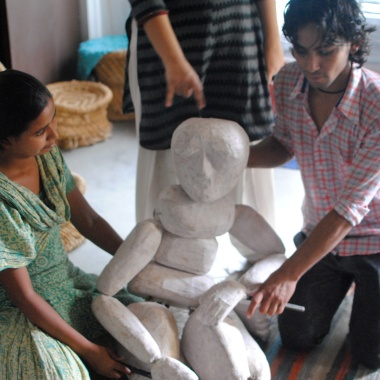 Asha, Anurupa and Anand show us their full-size Bunryaku puppet.